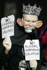 Protestor in Bush Mask demanding leadership on global warming