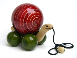 The Internet is teeming with online stores, catalogs and environmental groups that sell green-friendly gifts for the holidays. Pictured here: a child's snail pull-toy from Earthentree, made by artisans in India from sustainable wood that is dyed with natural vegetable dyes and finished with lead free non-toxic organic resin.