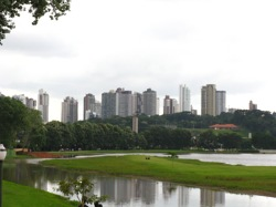 Urban areas all over the world are striving to lessen their environmental impacts by reducing waste, expanding recycling, lowering pollution and greenhouse gas emissions, and expanding open space. Pictured: Curitiba, Brazil, considered by many urban planners as the archetypal green city, as seen from Barigui Park