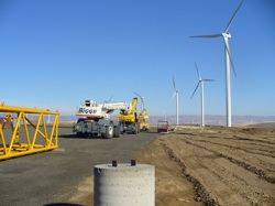 Most economists agree that it makes good sense to steer away from finite foreign oil toward homegrown renewable energy. Pictured: The Biglow Canyon Wind Farm under construction in Sherman County, Oregon